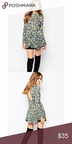 """Free People Annabelle Printed Tunic Vintage floral print covers mock neck tunic with a cutout back and ruffled hem. - Mock neck - Long sleeves - Approx. 32"""" length - Imported 70% rayon, 30% linen Hand wash cold Fit: this style fits true to size. Free People Tops Tunics"""
