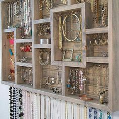 Jewelry, earring, bracelet, necklace holder out of a wooden shelf.  Great idea with many options.