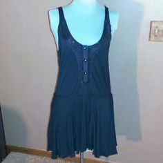 """Free People Tunic Black cotton tank tunic button up front has crochet and beading design around neck line ties in the back asymmetric hemline is 30""""long Free People Tops Tunics"""