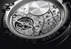 Breguet Marine Équation Marchante 5887 - the decorated movement, the self-winding Caliber 581DPE, can be seen through the caseback, including bridges engraved to depict a the Royal Louis, a ship in the French Royal Navy, and a barrel engraved with a windrose motif.