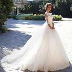 Item Type: Wedding Dresses Waistline: Natural is_customized: Yes Dresses Length: Floor-Length Neckline: Scoop Silhouette: A-Line Sleeve Length: Three Quarter Wedding Dress Fabric: Tulle For Pregnant W