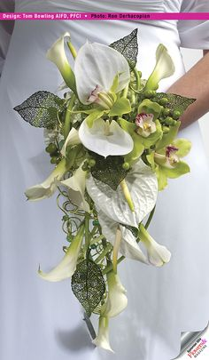 Tom created an armature with green aluminum wire wrapped with beaded boullion. Anthuriums, mini calla and cymbidiums were fed right through the armature. . Floral design by Tom Bowling AIFD. Photography by Ron Derhacopian. #wedding#centerpieces #bouquets.
