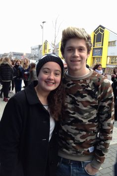 Niall with a directioner....where in the world did that camo come from<<< haven't you seen the pics of 9-ish yr old Niall in that army costume?