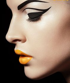 Perfect graphic black liner/shadow with a bright pop of yellow lips