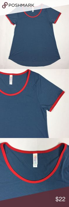 LuLaRoe Classic T Shirt Top Solid Blue Red Trim LuLaRoe Women's Size Small Classic T Shirt Top Solid Blue Red Trim Short Sleeves.  Pre-Owned. No flaws, holes or stains seen. Please see picture's for a visual detail of the item. LuLaRoe Tops Tees - Short Sleeve