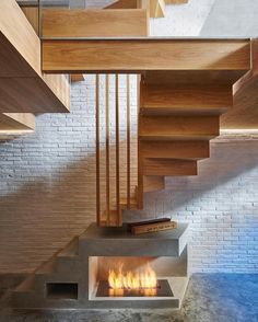 Check out this combo of different textures! Concrete floor, fireplace, & stairs combined w/ wood stairs, & a painted brick wall - so many design layers!