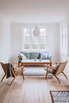Minimal, mid-century modern interior design for your living room. Includes big grid windows and a green loveseat. Simple Living Room, Living Room Modern, Home Living Room, Living Room Furniture, Living Room Designs, Living Room Decor, Living Spaces, Minimal Living, Minimalist Living Rooms