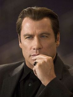 JOHN TRAVOLTA stars as Chili Palmer in MGM Pictures' comedy BE COOL.2005.