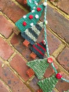 This is a pattern for 24 little Christmas trees to hang on an advent garland. Knit one a day for the days leading up to Christmas, or get ahead and knit them all now. They are quick and easy to make and great for using up yarn in your stash.