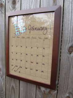 Dry Erase Calendar...Framed Burlap with Family Initial. Put Calendar base and days of week on the burlap. Then write the Month and numerical days with a dry erase pen.