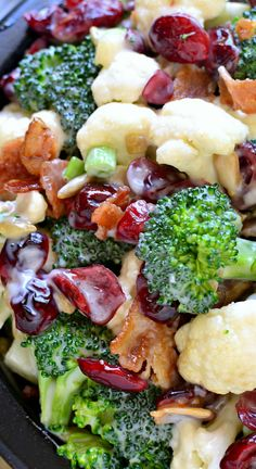 The BEST Broccoli Salad Recipe ~ Loaded with fresh broccoli, cauliflower, green onions, bacon, sunflower seeds, dried cranberries, and a lightened up honey mustard dressing... This salad is perfect for summer cookouts and picnics – a definite crowd pleaser