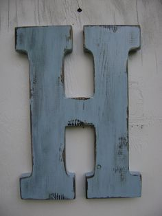 "Wooden letter rustic decor shabby chic letter ""H"" big wooden letters,initals, (baby's middle name) nursery,cabin,cottage,decor 12"" tall painted baby blue. $25.00, via Etsy."