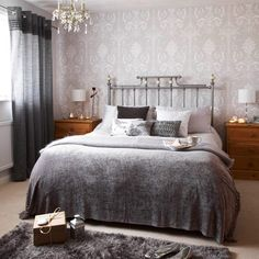 Grey master bedroom. I really like the wallpaper and soft furnishings