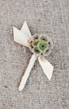 Too simple but I would be okay with a boutinere with a scabiosa pod.