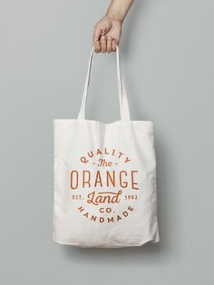 Free - Canvas Tote Bag MockUp | GraphicBurger - shopping bag - holding - hold - hand - shadow - white - orange text