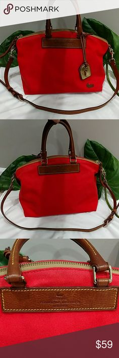"""DOONEY & BOURKE PURSE W/CLUTCH AND SHOULDER STRAP GREAT PRE-OWNED CONDITION. BROWN LEATHER, YELLOW COTTON INNER LINING, CORAL/RED COTTON SHELL. COMES WITH DUCK CHARM. NO MAJOR SCUFFS IT MARKS WORTH MENTIONING. IS A GENTLY GENTLY USED PURSE. DIMENSIONS 10X 12X 6"""" Dooney & Bourke Bags"""