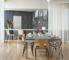 Loft dining room with shiny pendant lights