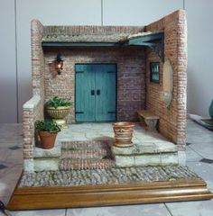 This courtyard was inspired by a basilica my daughter and I visited in Rome last year. It is made using gatorboard and paperclay. Modern Dollhouse, Diy Dollhouse, Dollhouse Miniatures, Miniature Rooms, Miniature Houses, Miniature Gardens, Gnome House, Ceramic Houses, Tiny World