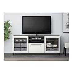 "IKEA - BESTÅ, TV unit with drawers, black-brown/Marviken white clear glass, drawer runner, soft-closing, 70 7/8x15 3/4x29 1/8 "", , The drawer and doors close silently and softly, thanks to the integrated soft-closing function.You can control your electronic equipment with the doors closed, as the remote control works through the glass.It's easy to keep the cords from your TV and other devices out of sight but close at hand, as there are several cord outlets at the back of the TV bench.The…"