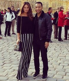 Soaking in the sights: Chrissy Teigen and John Legend went sightseeing at France's iconic ...