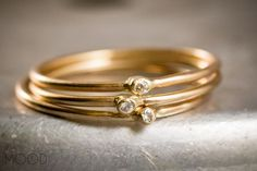 Three White Diamond stacking skinny rings in 14K Yellow Gold.
