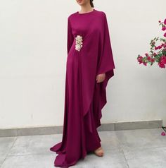 Kaftan season is on! And we have this gorgeous Ruby Drape kaftan with embroidered gold ribbon detailing available now. Don't forget to use the sale code: for off ! Abaya Fashion, Muslim Fashion, Gothic Fashion, African Fashion Dresses, Fashion Outfits, Modest Fashion, Morrocan Fashion, Mode Abaya, Silk Kaftan