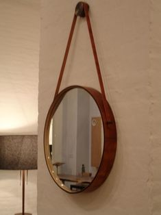 DIY Leather Captain's Mirror based on Ikea's Grundtal mirror $30 plus cost of leather belts and wall hanger