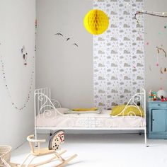 kids room with white and a toutch of yelow