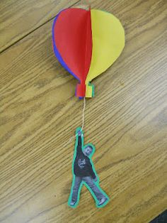 oh the places you'll go- 4 different colored symmetrical balloons & string & silly pic of kid on construction paper