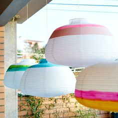 Instead of using them for lighting, paint paper lamp shades to create decorations. Each one takes just a few minutes to do but they create instant impact and help define the space from the rest of the home. It's lovely to watch them sway gently in the breeze.