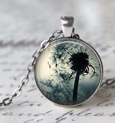 This 24 inch chain necklace features a 1 inch pendant with a high quality print of a dandelion. The print has been sealed with a magnifying glass dome. All of our necklaces come packaged in a kraft co