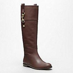 Martta Boot at Coach.  Looking for an English style riding boot, and I love the lead line clip detail.
