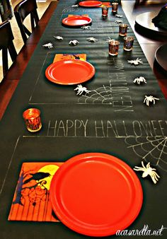 This chalkboard table runner is just a piece of black bulletin board paper.