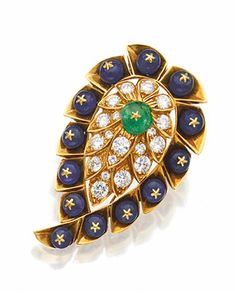 SAPPHIRE, EMERALD AND DIAMOND BROOCH, VAN CLEEF & ARPELS, NEW YORK.  The paisley motif set in the center with an emerald bead, framed by 19 round diamonds weighing approximately 3.25 carats, the borders accented with sapphire beads, mounted in 18 karat gold, signed Van Cleef & Arpels, numbered N.Y. 36445.