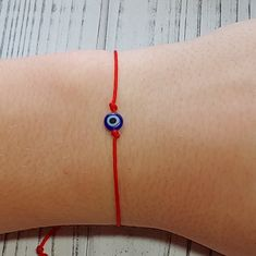 This evil eye bracelet comes on a card with information on the meaning of evil eye charms and red string bracelets making it a thoughtful Christmas gift 🎄 String Bracelet Making, Red String Bracelet, Lava Bracelet, Evil Eye Bracelet, Simple Bracelets, Wish Bracelets, Cord Bracelets, Christmas Gifts For Friends, Evil Eye Charm