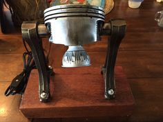 Piston Lamp mounted on a lovely wood base.