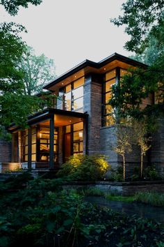 #exterior. There is something that just fits about a brick exterior with black framed windows and a lush garden.