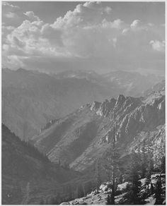 """Original Caption: """"Middle Fork at Kings River from South Fork of Cartridge Creek, Kings River Canyon (Proposed as a national park),"""" California, 1936. (vertical orientation)  U.S. National Archives' Local Identifier:  79-AAH-26  From: Series: Ansel Adams Photographs of National Parks and Monuments, compiled 1941 - 1942, documenting the period ca. 1933 – 1942  Created By:  Department of the Interior. National Park Service. Branch of Still and Motion Pictures.  Photographer: Adams, An..."""