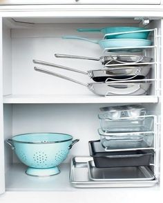 Turn a vertical bakeware organizer on its end and use it to stack pans horizontally