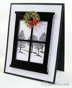 handmade Christmas card from KC Poppy Stamps Grand Madison Window ... black and white ... Lovely as a tree trees in background outside four pane window ... cute little wreath of punched green, red sequins and bow ... like the dramatic effect of the black window casings ... great card!