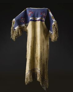 A LAKOTA BEADED HIDE DRESS    composed of hide, glass beads, and cotton thread.  Length 52 1/2 in. Click to enlarge: http://assets3.pinimg.com/upload/137641332332888969_womdd5Sa.jpg