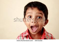 Excited face of a small boy - stock photo