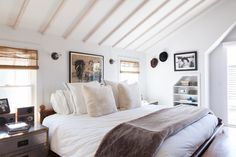 Exposed beams, pitched ceiling, restful neutrals | Lonny