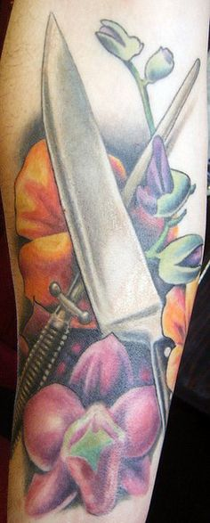 Chef's knife and flowers tattoo by DeadlyInk, via Flickr