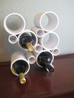 If you enjoy modern decor, embrace PVC pipe's industrial look by crafting an abstract wine holder that's sure to be a conversation piece. Click through for the tutorial and more DIY PVC pipe organizers.