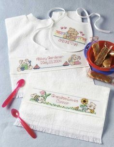 Special Bibs for Special Babies - Personalized bibs celebrate the fact that all babies are special. Choose from 14 simple cross stitch designs by Ursula Michael and two different alphabets to personalize a bib for your baby. All stitched on prefinished bibs, the designs vary from lively fruit and veggies to cute bunnies and bears. 14 designs, all with space for adding a name: Fruit; Veggies; Hug Me (bears); Feed Me! (bear); I Love You (bunny); Bunny and Blanket; I Love Daddy (bunny, with…