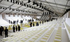 Louis Vuitton: Marc Jacobs' latest collection for the brand focused on its iconic Damier print, which artist Daniel Buren also drew on for the show set at the Palais Royal. The models descended four sets of escalators in pairs, before stepping onto a wide, lime green shiny checkerboard catwalk