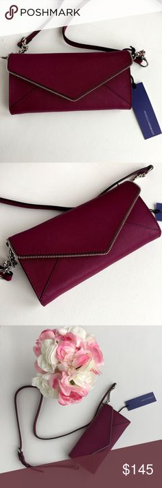 New Rebecca Minkoff Soft Berry Cleo On a Chain A sharp envelope flap takes it to the edge with zipper teeth lining on this tough, Saffiano leather crossbody wallet. Featuring divided compartments & a multitude of 8 card slots & pockets, this chic look is finished with butterfly-patterned lining & glossy black hardware. Simply detach the strap for a smart evening clutch. Magnetic snap-flap closure. Optional, adjustable chain-link & leather strap. Exterior slip pocket Interior zip divider…