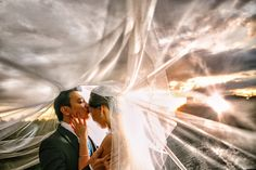 Love this beneath-the-veil shot! Ahren and Talyn's Teal and Hot Pink Wedding in the Philippines. Photography by Eugene Martinez Photography.