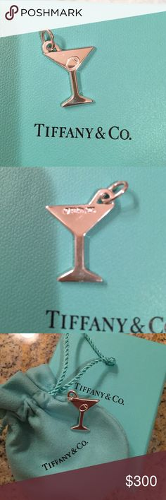 Tiffany & Co charm Tiffany & Co martini glass with olive sterling silver charm for bracelet or necklace. Oval clasp. Rare piece. $400 value.  Comes with little blue box and pouch Tiffany & Co. Jewelry
